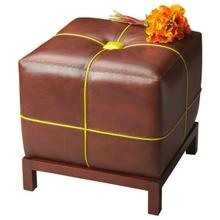 See Details - This versatile leather ottoman with a button-tufted cushioned top functions as a stand alone piece or can be used in multiples in front of a sofa. The contrasting welt sets it apart from most other ottomans. The frame is made of select hardwoods.