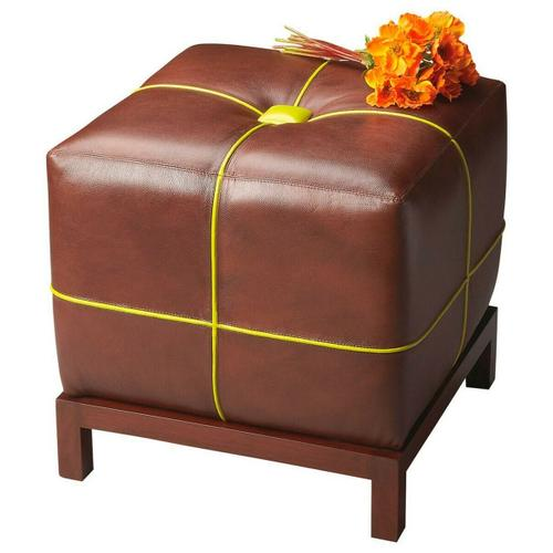 Butler Specialty Company - This versatile leather ottoman with a button-tufted cushioned top functions as a stand alone piece or can be used in multiples in front of a sofa. The contrasting welt sets it apart from most other ottomans. The frame is made of select hardwoods.