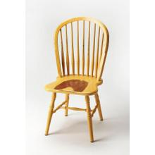 Bring farmhouse charm to your dining room or office space with this classic Windsor back side chair. Crafted from mahogany wood solids with a spindle-back design, it features an aged yellow heirloom finish.