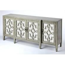 Perfect addition to just about every dining room or living area; a storage friendly sideboard. This traditionally styled sideboard boasts of majestic influences with a contemporary appeal. The overall dimensional design is embraced with the soft curves of the door panel fretwork. The additional light reflection that will bring a soft reflected light into your room is brought by the antique mirror panels on the panel doors. Crafted in Birch wood solids and veneers with an updated finish color lend a classic design with a nuance of contemporary color. This is the perfect addition for your room space and all of your entertaining and living storage needs.