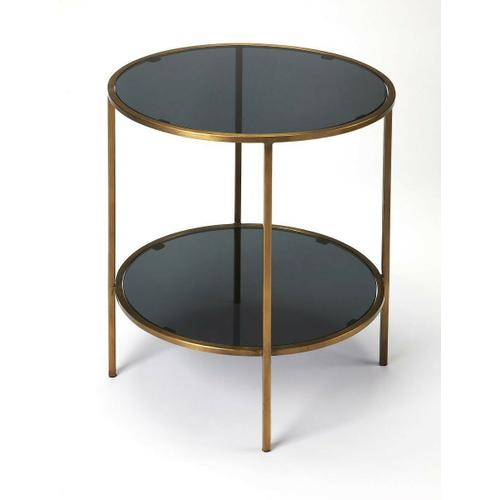 Enhance your living room, bedroom or office with this modern two-tiered round end table. Forged from iron, its antique gold finished frame supports a black glass top and bottom shelf.