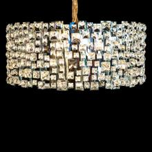 Designed With A Collage of Crystal On Stainless Steel, This Glamorous Chandelier Offers A Dramatic Centerpiece To Your Modern Room.