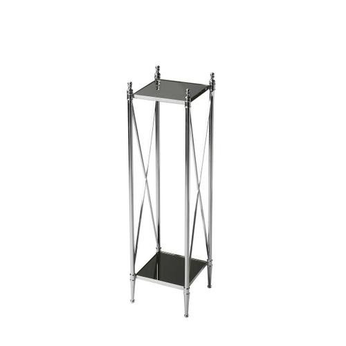 This double-decker pedestal stand will be a striking addition to any modern space. Four perfectly proportioned legs meet the floor in delicate ballerina feet. Crafted from iron, glass and aluminum components, its glossy mirrored glass top and bottom shelf