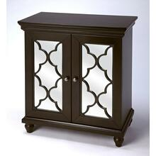 Versatility that is making a style statement within this mirrored chest. The beautifully cut fretwork adorned over the mirror paneled doors simply capture the eye. The beauty of the rich Birch veneers are captured by the destinctive color finish to add a bit of warmth to your elegance.The interior cabinet space with its shelf offers endless possibilities for your storage needs. The statement piece for almost every room can be yours just for the taking.