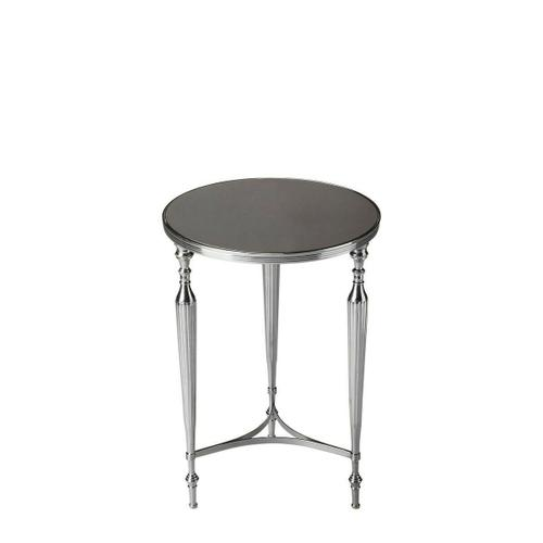 Remarkably modern, yet somehow very familiar, this elegant table was designed to blend with virtually any type of d cor. Notice how its beautifully tapered legs slip into elegant ballerina feet, and the way it's all brought together just above the ankles with three bending sides of an equilateral triangle. Crafted from iron and aluminum, it features a radiant granite top with a shimmering Nickel finish.