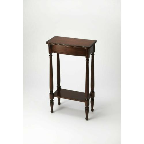 A graceful bright spot for a small space, the hallmark of this Console Table's exquisite design is the prominence of four slender legs ™ carved and turned and immaculately shaped. The petite tabletop and apron shimmer in traditional Plantation Cherry
