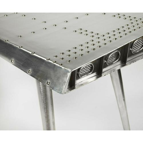 Butler Specialty Company - This Desk is riveting, soaring with the flair of an airplane wing and guaranteed to help a room take flight. Crafted from polished aluminum and rivets, this shimmering desk sits atop four matching legs that taper down for a very smooth landing indeed.