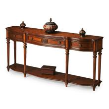 See Details - This gorgeous console exudes grandeur. Crafted from select solid woods, wood products and choice veneers, it features a shapely top, lower shelf and drawer fronts all done in oak veneers. The legs have a fluted design with hand carved acanthus leaf detail. Three drawers with resin accents and antique brass finished hardware.