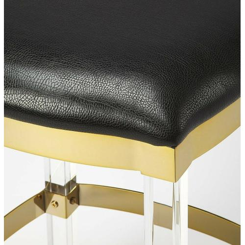 Easily elevate the look of your kitchen with this leather and acrylic counter stool. The beauty of this counter stool is allowed to shine through its design, featuring acrylic legs, a soft seat and metallic trim and foot rest, gives your room an airy glamourous appeal. The neutral hue of the upholstered top works in many aesthetics.