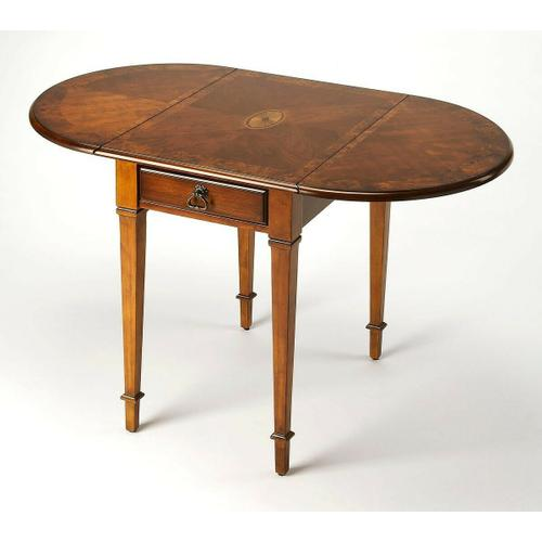 Butler Specialty Company - Thanks to its drop-leaf design, this antique reproduction pembroke table is wonderfully versatile and suitable for both small spaces and larger rooms. Handcrafted from select wood solids and wood products, the top features a maple and walnut veneer linen-fold inlay design set within matched birch veneers, matched birch veneer leaves and an olive ash burl veneer border. Includes one drawer with antique olive ash burl veneer and antique brass finished hardware .