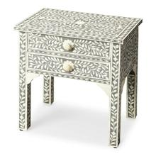 View Product - Grey is the newest neutral, married to handcrafted bone inlay in an eye catching vine pattern to create the perfect lamp table or bedstand. The two drawers have delicately carved bone pulls that mirror the shimmering pearlesque detail.