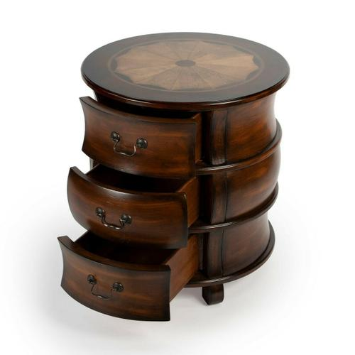 Butler Specialty Company - This traditionally styled barrel table is destined to be a distinctive addition in the living room as an end table or in the bedroom as a nightstand. Crafted from poplar hardwood solids and manufactured wood products, it features stunning linen-fold inlays of maple and walnut veneers framed within a border of cherry veneer. Boasts a rich Plantation Cherry finish and three ample storage drawers with antique brass finished bale pulls.