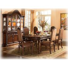"""View Product - A deep rich stained finish and exquisite details come together to create the ultimate in grand traditional design with the elegance of the """"North Shore"""" dining room collection. The opulent brown stained finish flows beautifully over the decorative pilasters and ornate detailed appliques to create a rich elegant atmosphere to any dining experience. With the comfort and beauty of elegantly upholstered chairs, this furniture collection takes traditional style to the next level. Transform your dining area with the rich style of the """"North Shore"""" dining room collection."""