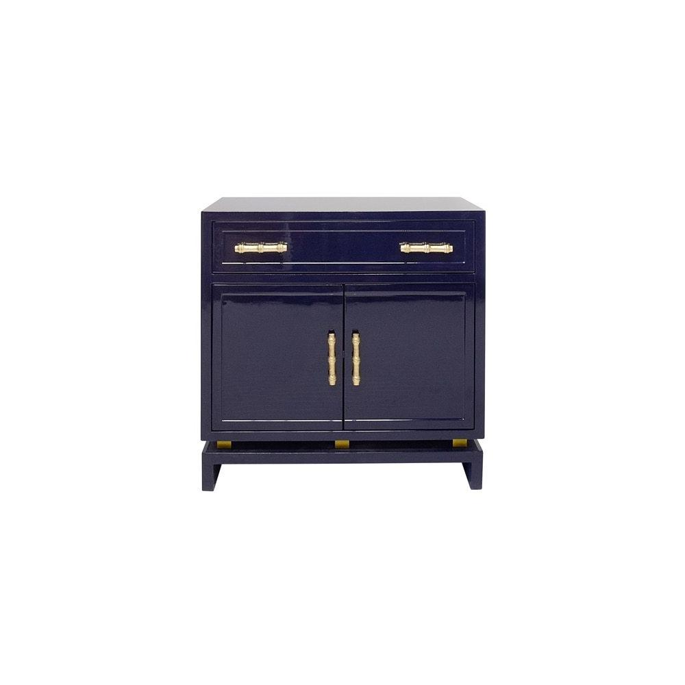 This Charming, Asian-inspired Lamp Table Instantly Elevates Your Space. Whether Adorning A Hallway or Living Room, the Bold Combination of Glossy Navy Lacquer and Gold Leaf, Bamboo Style Hardware Delivers A Next Level Design Aesthetic. Plenty of Useful Storage With Drawer and Cabinet, So Marcus Is Not Only Gorgeous, But Also Practical.