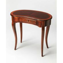 See Details - This elegant Writing Desk features a crescent shape tabletop supported by four stylized, tapered cabriole legs and a drawer with antique brass-finished hardware. It is crafted from solid poplar and cherry veneer in a rich Plantation Cherry finish.