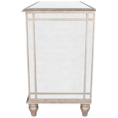 This glamorous console chest features elegant antique mirror inlays on its top, drawer fronts and sides. No detail is overlooked with a beveled edged top and striking pewter finished trim. Handcrafted from select hardwood solids and wood products with antique brass finished hardware.
