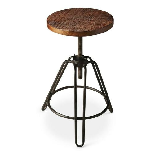 This charming industrial-look barstool revolves and adjusts to the desired height, making it an ideal seat for all sizes and tables. With a distressed recycled wood seat, its three-legged design ensures stability and iron circle base serves as a convenient foot-rest. Crafted entirely from iron and recycled wood solids.