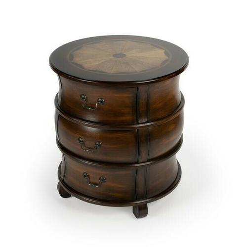 This traditionally styled barrel table is destined to be a distinctive addition in the living room as an end table or in the bedroom as a nightstand. Crafted from poplar hardwood solids and manufactured wood products, it features stunning linen-fold inlays of maple and walnut veneers framed within a border of cherry veneer. Boasts a rich Plantation Cherry finish and three ample storage drawers with antique brass finished bale pulls.