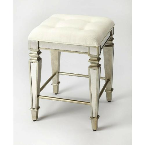 This glamorous counter stool delivers vintage style to your home with antique mirror inlays along its legs and apron and a tufted cotton upholstered ivory cushion. It is hand crafted from select hardwood solids and wood products featuring a pewter finish for a stylish contrast.