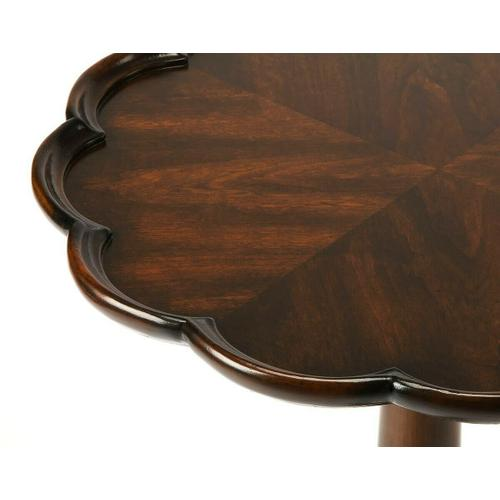 Selected solid woods and choice cherry veneers. Four-way matched cherry veneer top with pie crust frame. Resin appliqu s.