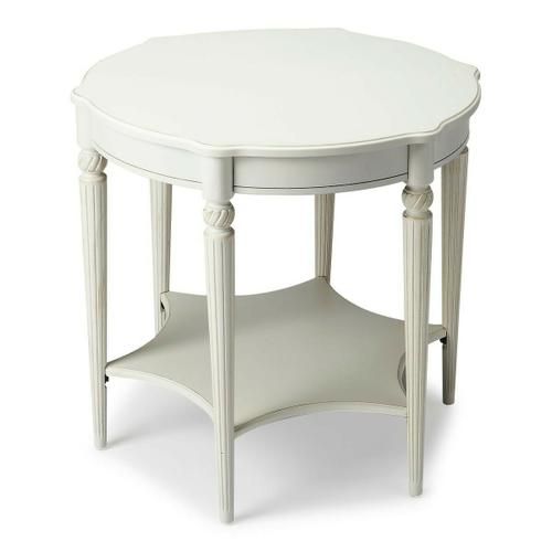 This elegant table blends classic Old World styling with today's casual sophistication. Crafted from hardwood solids, wood products and birch veneer, it boasts an ample round top with a distinctive lower display shelf in the shape of a six-pointed star joined together by beautifully carved fluted legs.
