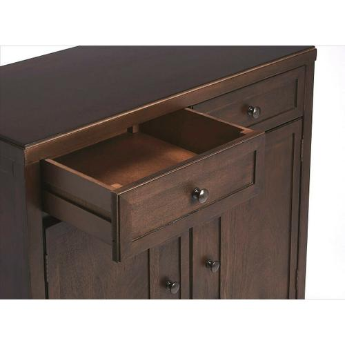 Butler Specialty Company - This stylish console cabinet combines Modern minimalism with Eastern design elements. Featuring clean lines and a Coffee finish, its inner storage cabinet and two drawers make it a great addition in an entryway, hallway or living room. Crafted from bayur wood solids and wood products with nickel finished hardware.