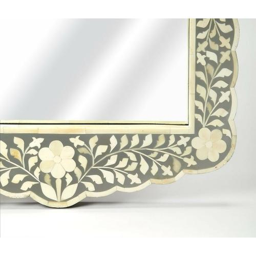 This magnificent wall mirror features sophisticated artistry and consummate craftsmanship. The botanic patterns covering the piece are created from white bone inlays cut and individually applied in a sea of gray hues by the hands of a skillful artisan. No two mirrors are ever exactly alike, ensuring this piece will hang as a bonafide original.