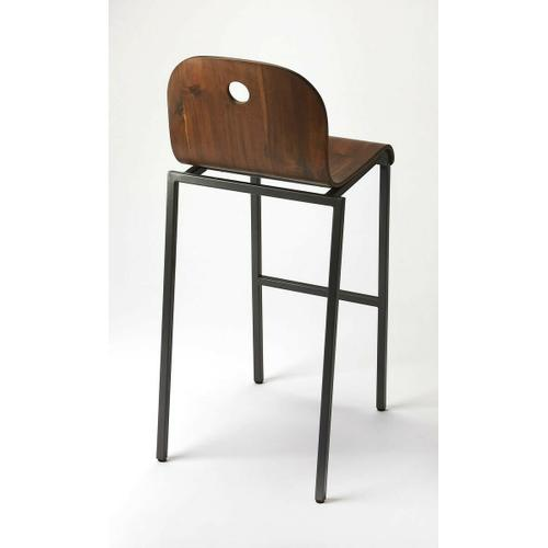 Enhance your kitchen, bar or work space with this modern bentwood bar stool. Its high-back rectangular seat features acacia veneer in a walnut finish with a black steel tube base and footrest.