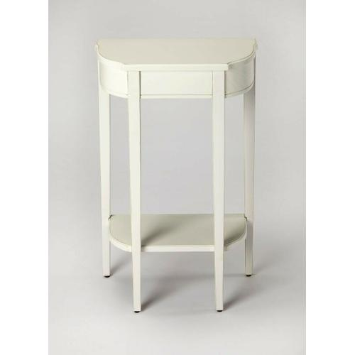 Butler Specialty Company - A spot of elegance for a small space, this console table's harmonious design begins with the slender legs, gracefully tapered. The beautiful symmetry of tabletop and bottom shelf adds to the effect, which is consummated in a Cottage White finish on cherry veneer.