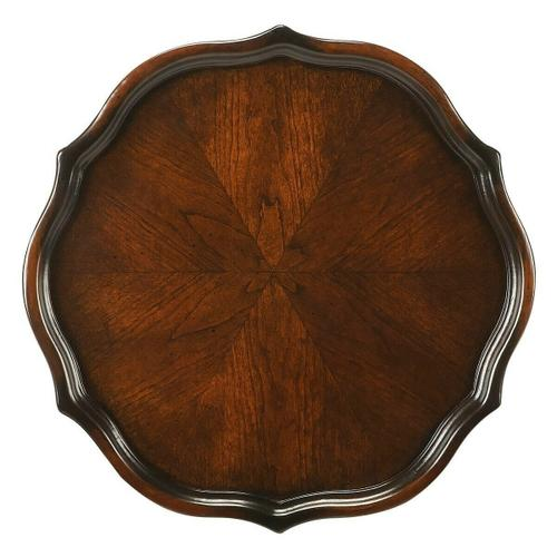 Selected solid woods and choice veneers. Six-way matched cherry veneer top with raised shaped edge.