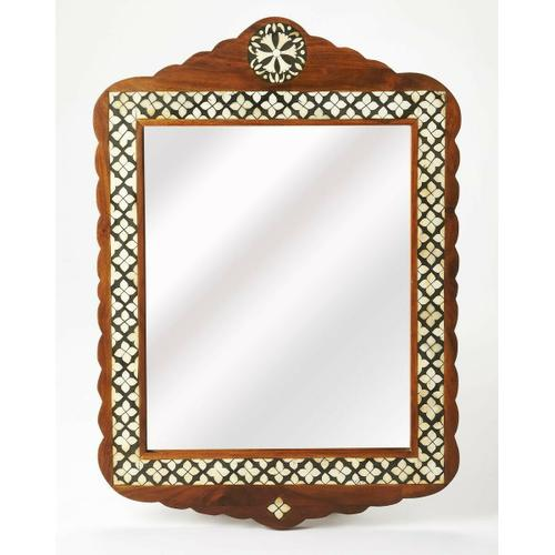 This arched top wall mirror is an extraordinary feat of craftsmanship. Its wondrous Moroccan quatrefoil design is painstakingly created inlaying bone ™ within a merranti wood frame ™ one individual piece at a time. Its hand rubbed finish will elegantl