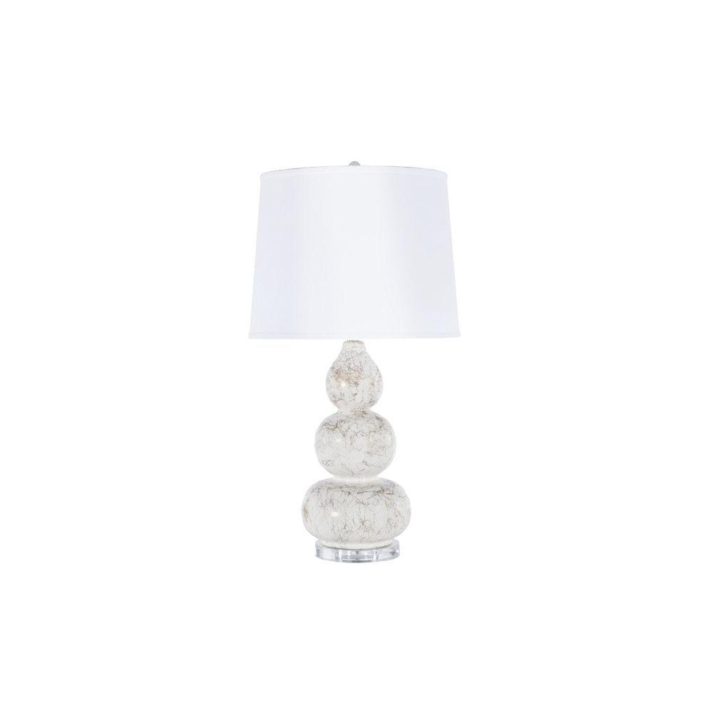 With Its Curvaceous and Shapely Silhouette, the Delaney 3 Tier Lamp Makes A Statement Without Saying A Word. Features an Extraordinary Gold Marbling Detail On the White Base, Lucite Pedestal Foot, and Crisp White Linen Shade.
