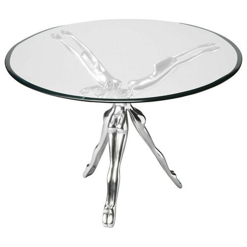 Three shimmering female forms come together to support the beveled glass tabletop in the mesmerizing design conceit of this Accent Table. The base is nickel-finished metal.