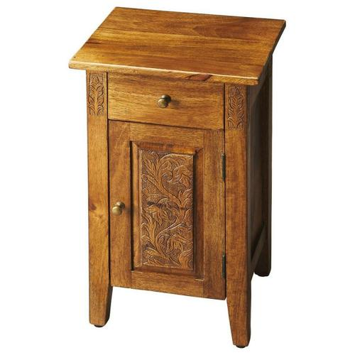 Butler Specialty Company - The warm amber finish provides the perfect complement to this chairside chest's simple lines, brass-finished hardware and botanic flourishes carved on door panel and either side of the drawer front. An instant classic, crafted from mango wood solids and wood products.