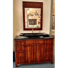 Furniture Guild vanity with Stone Forest counter top (complete with AdNotum in mirror HD TV)