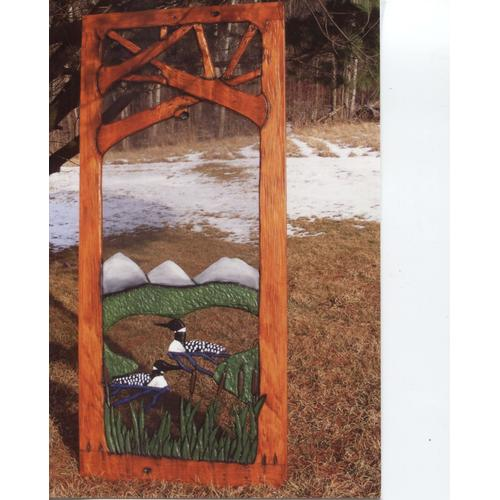 Handmade rustic wooden screen door featuring loons on a lake.