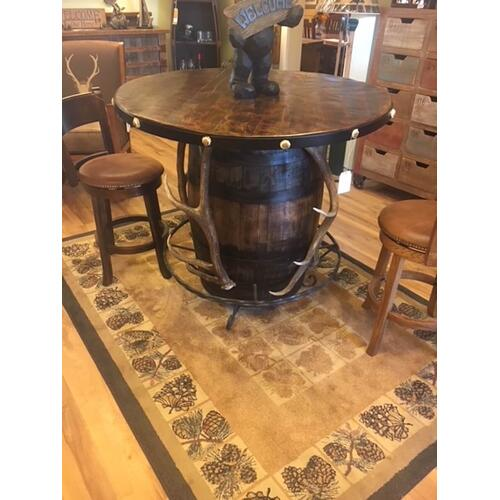 Whiskey barrell pub table w/ antler accents.