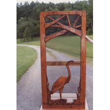 Handmade rustic wooden screen door featuring a great blue heron.