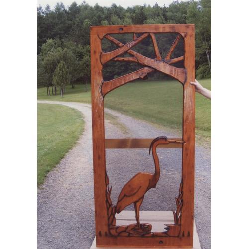 Handmade rustic wooden screen door featuring a great blue heron.
