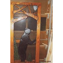 Handmade rustic wooden screen door featuring a black bear.