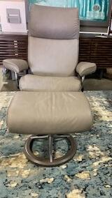 Stressless: Aura Medium Signature Base Chair and Ottoman