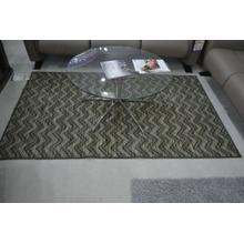 Ashley Furniture green zig zag area rug.
