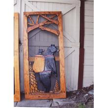 Handmade rustic wooden screen door featuring a bear and cub.