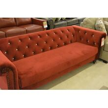 Red velvet 3 seater sofa, with nail head finish on the arm faces and gem head finish on the back.