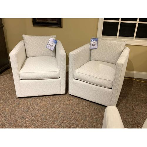 Pair of Swivel Barrel Accent Chairs