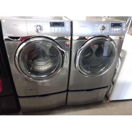 Refurbished  Silver STEAM Samsung Front Load Washer Dryer Set On Pedestals Please call store if you would like additional pictures. This set carries our 6 month warranty, MANUFACTURER WARRANTY AND REBATES ARE NOT VALID (Sold only as a set)