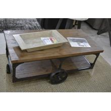 Product Image - Ashley Furniture wood and metal wheeled rusic cocktail table.