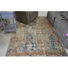 Ashley Furniture blue and orange multi color area rug.