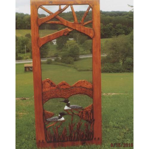 Handmade rustic wooden screen door featuring loons.