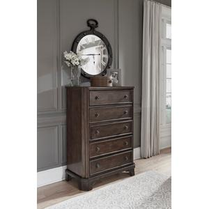 You love the look of traditional furnitureas long as its not overly formal. Behold the best of both worlds in this chest of drawers. The combination of classic and up-to-date design proves that opposites really do attract. Large profile pilasters and bracket feet add a distinctive touch to the chest's clipped corners, beveled edges and relaxed finish. With all these fine details, you can dress up a room, yet keep it feeling casual for today's lifestyle.
